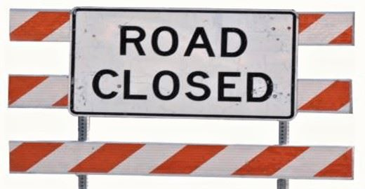 road closed sign and barricade