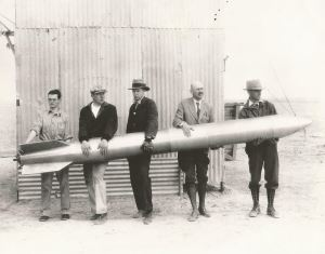 Goddard and his team with a rocket