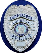 RPD officer badge (website)
