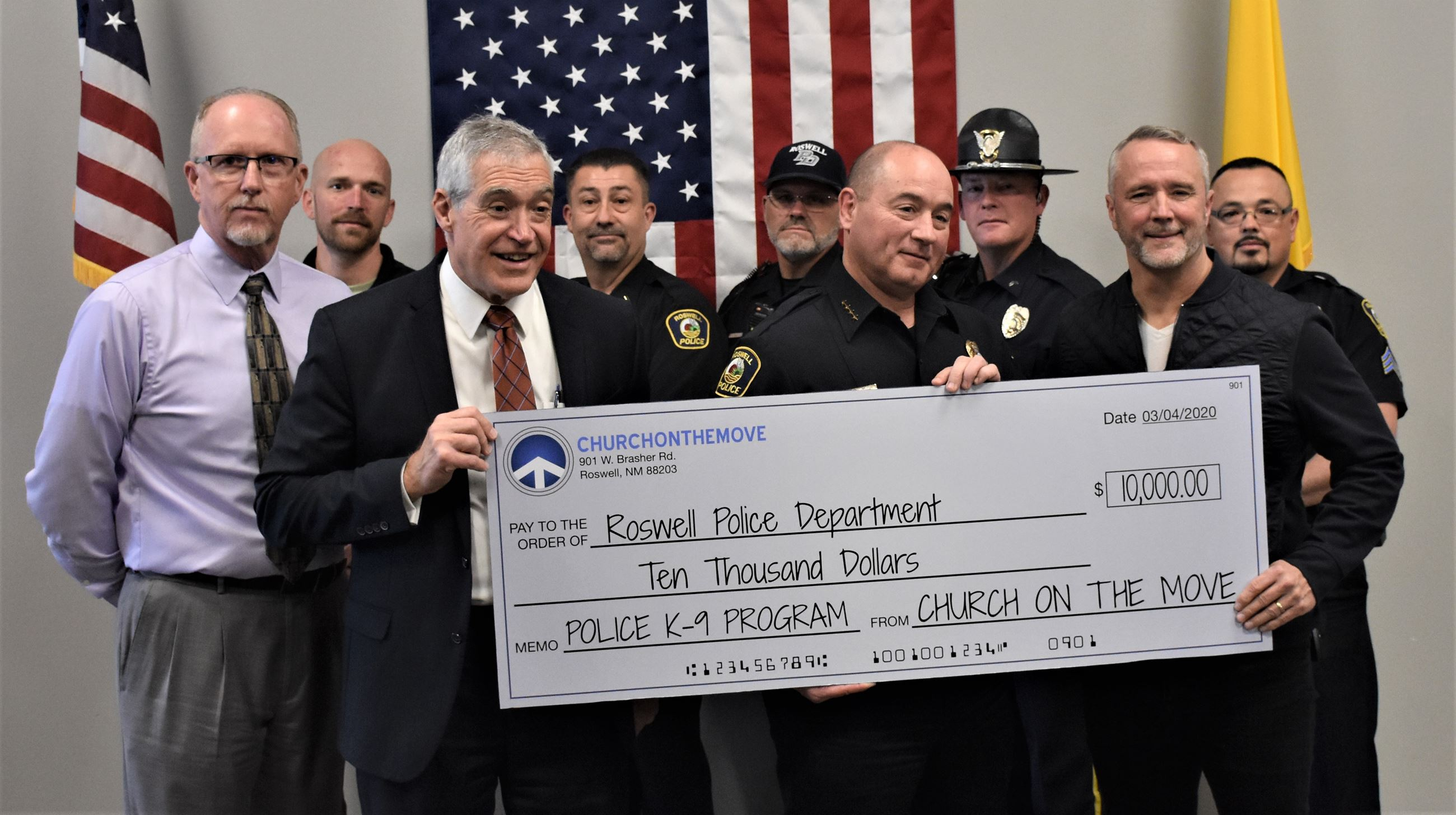 Church on the Move presents check for RPD K9 program (3-4-20)