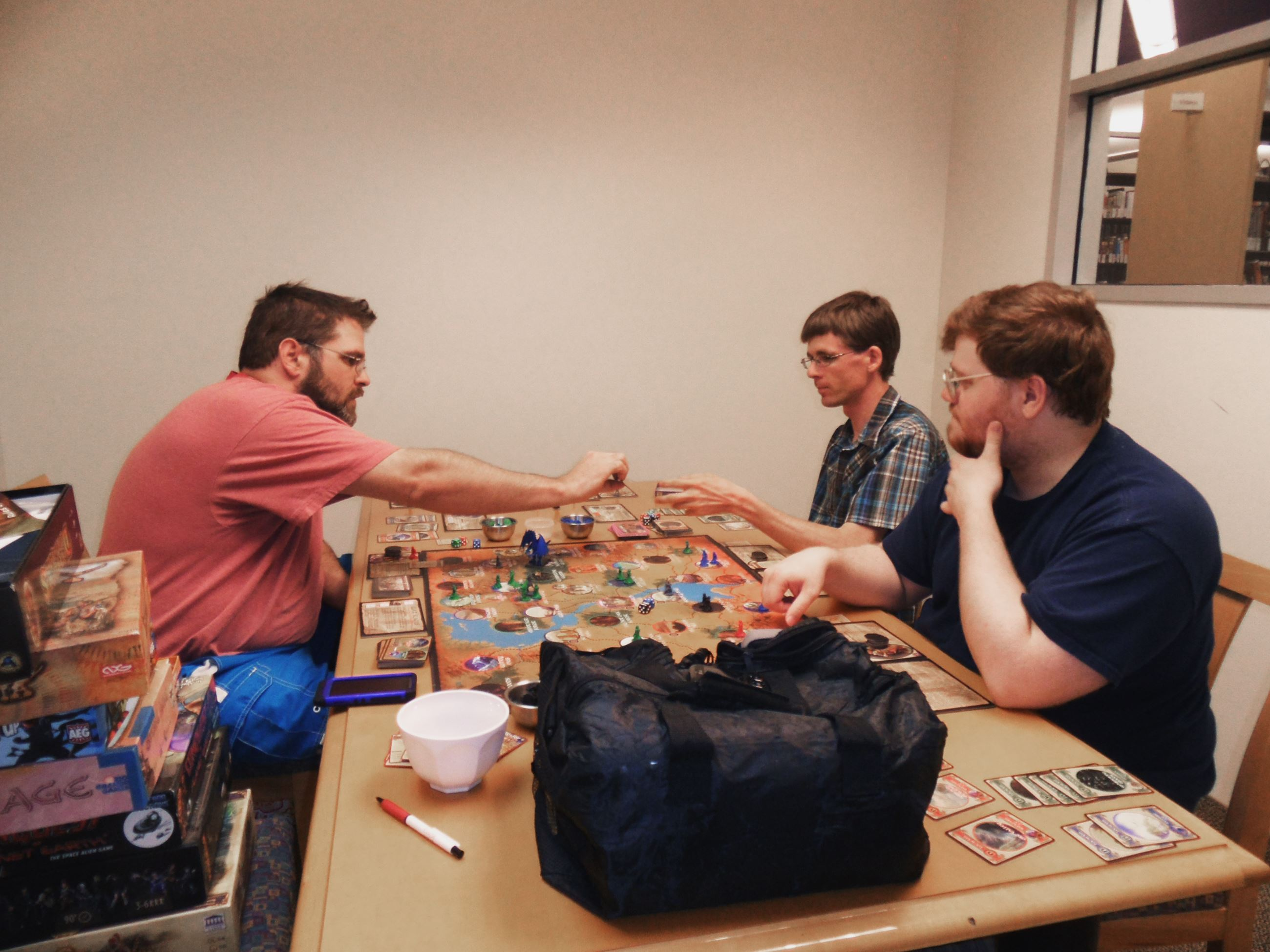 Study Room being used for board games by three male patrons