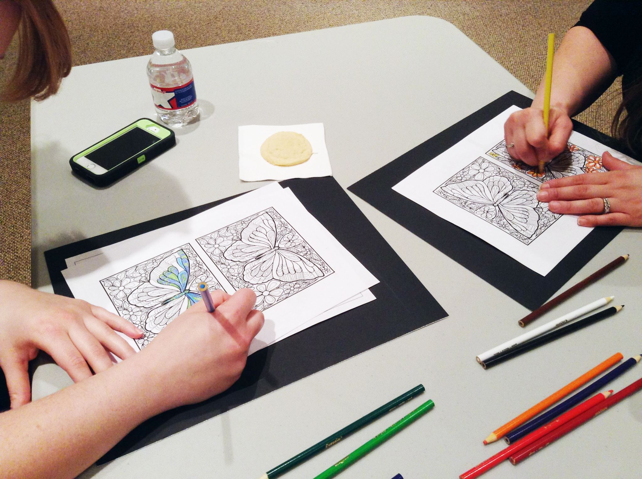 colored pencils and coloring sheets for adults